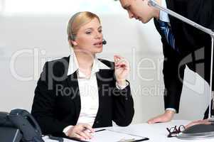 Female executive discussing business issue