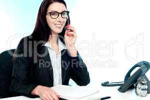 Female customer care executive holding mic