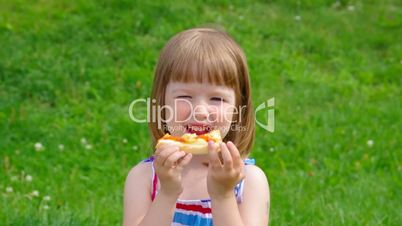 girl eating a slice of cheese pizza