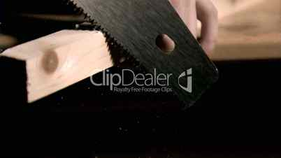 Saw cutting in super slow motion wood