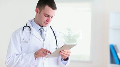 Young doctor using a tablet computer