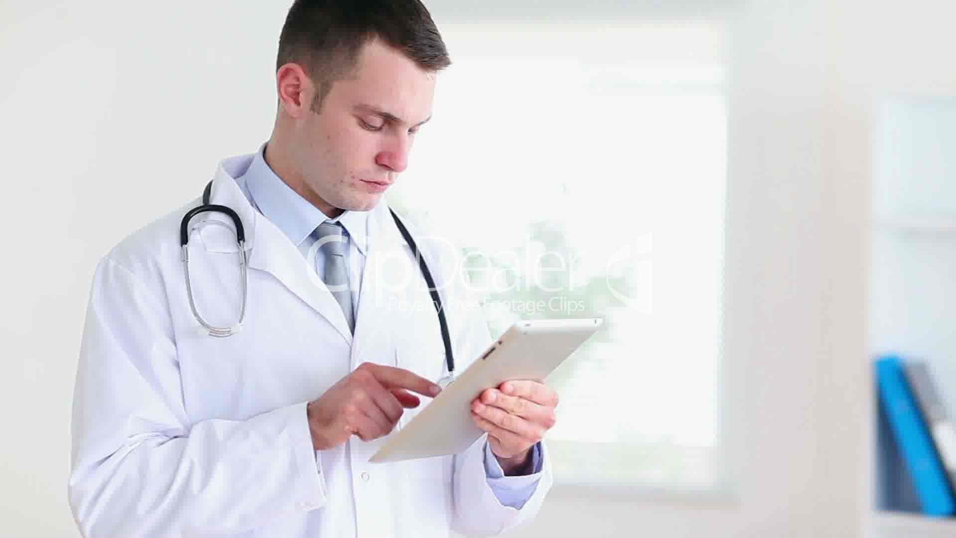 Young Doctor Using A Tablet Computer Royalty Free Video