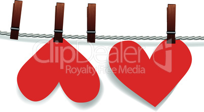 Heart paper attached to a clothesline with pin.