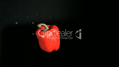Red bell pepper turning in super slow motion