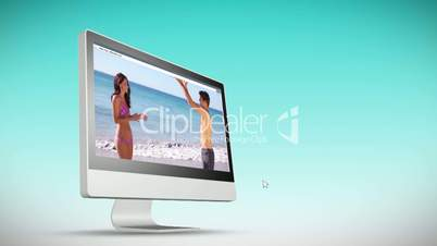 Videos of holidays at beach on a computer screeen