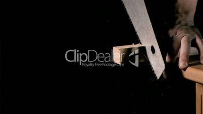 Man sawing in super slow motion a piece of wood