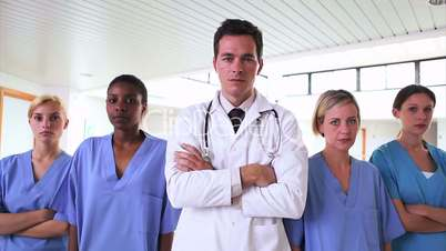 Doctor and nurses with arms crossed