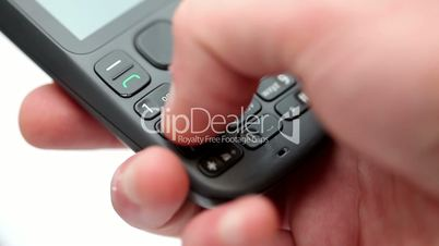 Hand dialing a number on a mobile telephone