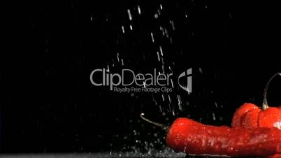Colorful vegetables in super slow motion being soaked