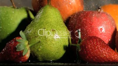 Fruits being watered in super slow motion