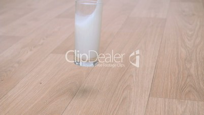 Glass of milk in super slow motion splashing