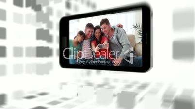 Videos of a family in living room on a smartphone screen
