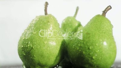 Water in super slow motion dripping on pears