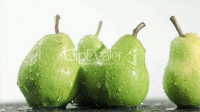 Pears in super slow motion being soaked