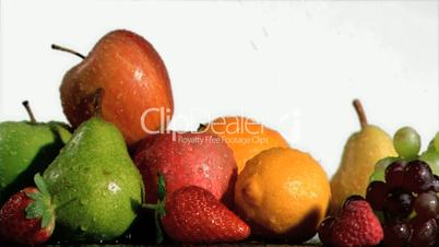 Fruits being soaked in super slow motion