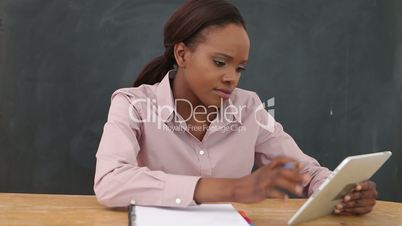 Video of an upset black woman at desk