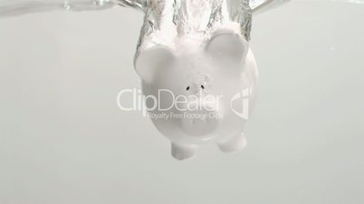 Piggy-bank diving in super slow motion in water