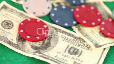 Coins and dollar spinning on a gambling table