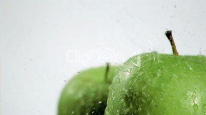 Rain falling in super slow motion on apples