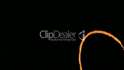 Orange paint line in super slow motion rising