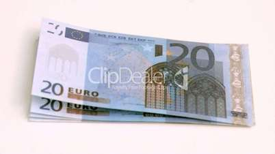 Wind blowing in super slow motion on european banknotes