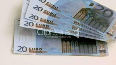Euro notes in super slow motion rising up