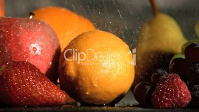 Water dripping in super slow motion on fruits