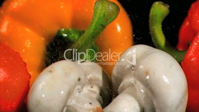 Drops falling in super slow motion on vegetables