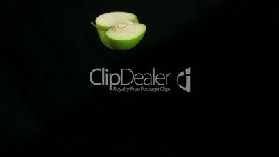 Green apple slice rotating in super slow motion