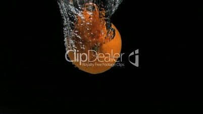 Orange diving in super slow motion into water