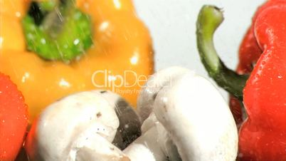 Vegetables watered in super slow motion in close-up
