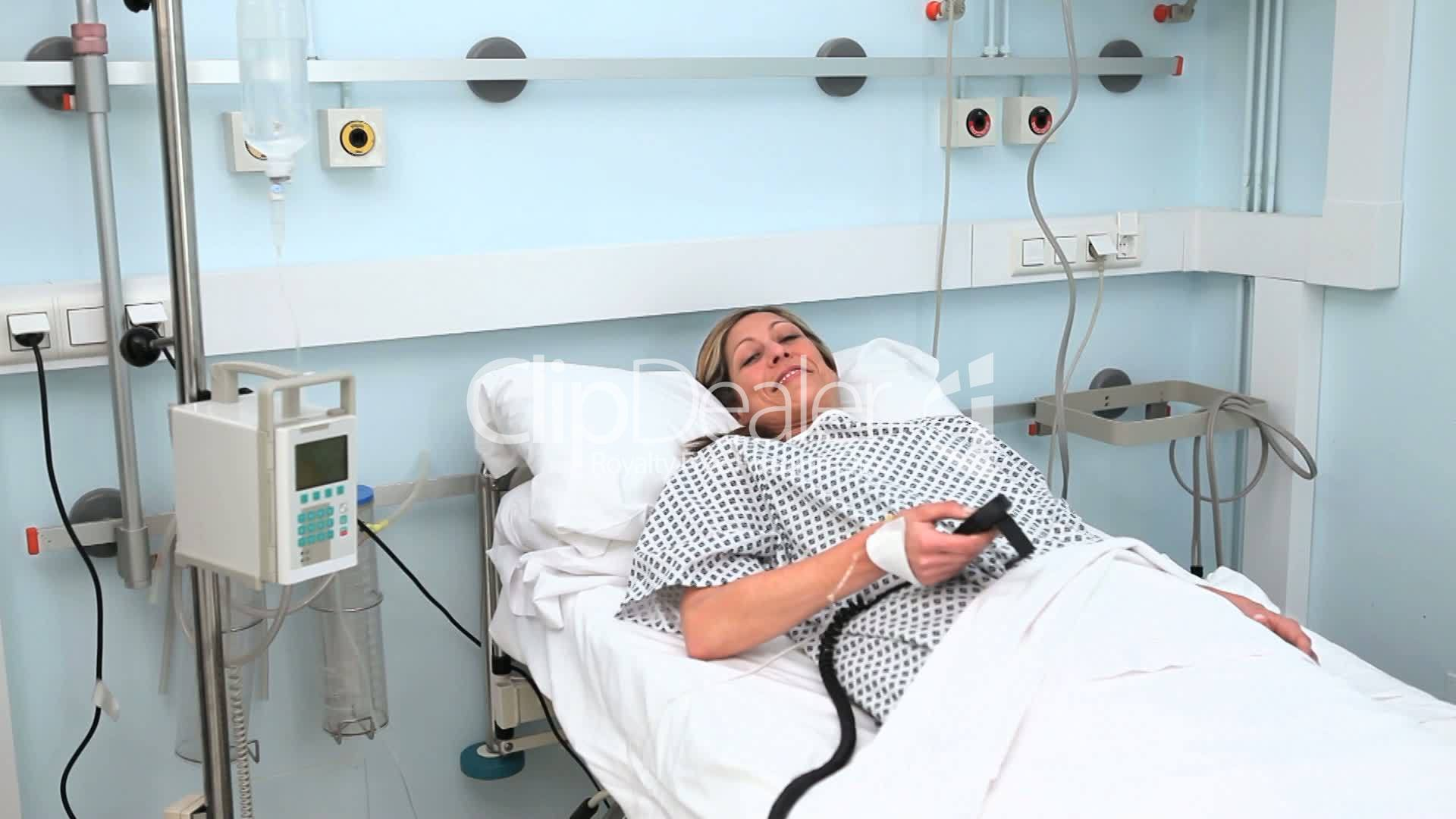female patient lying on a bed while looking at camera