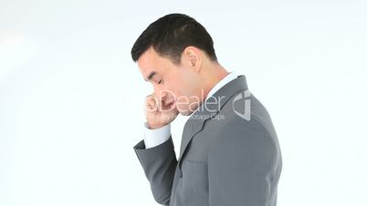 Side view of a businessman calling with his phone