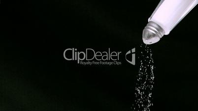 Salt falling in super slow motion from a salt shaker