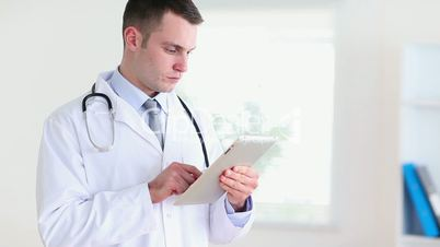 Doctor using a tablet tactile