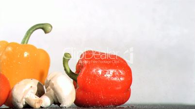Peppers and mushroom watered in super slow motion