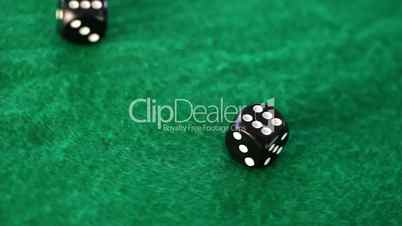 Dices thrown on a gambling table
