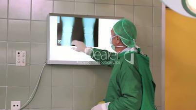 Surgeon checking x-rays