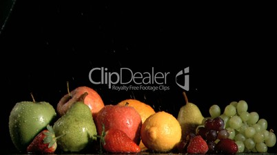 Many fruits sprayed in super slow motion with water