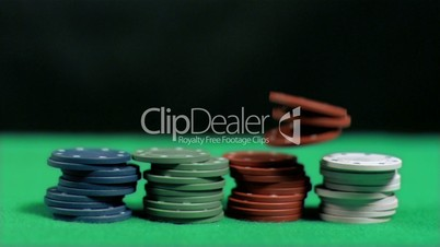 Poker chips falling in super slow motion on other chips
