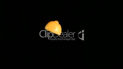 Lemon slice turning in super slow motion
