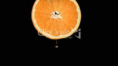 Drop falling in super slow motion from an orange slice
