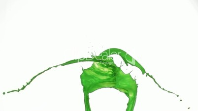 Green splashes of paint in super slow motion falling
