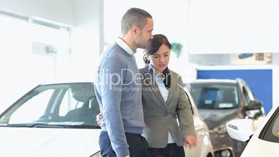 Couple discussing about a car