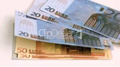 European banknotes being blown in super slow motion