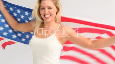 Woman holding a USA flag