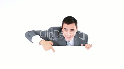 Businessman pointing something on a board