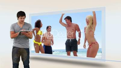 Man watching his vacation at beach on tablet computer