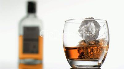 Whiskey in super slow motion overflowing