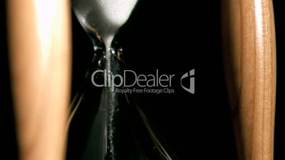 Hourglass in super slow motion containing sand